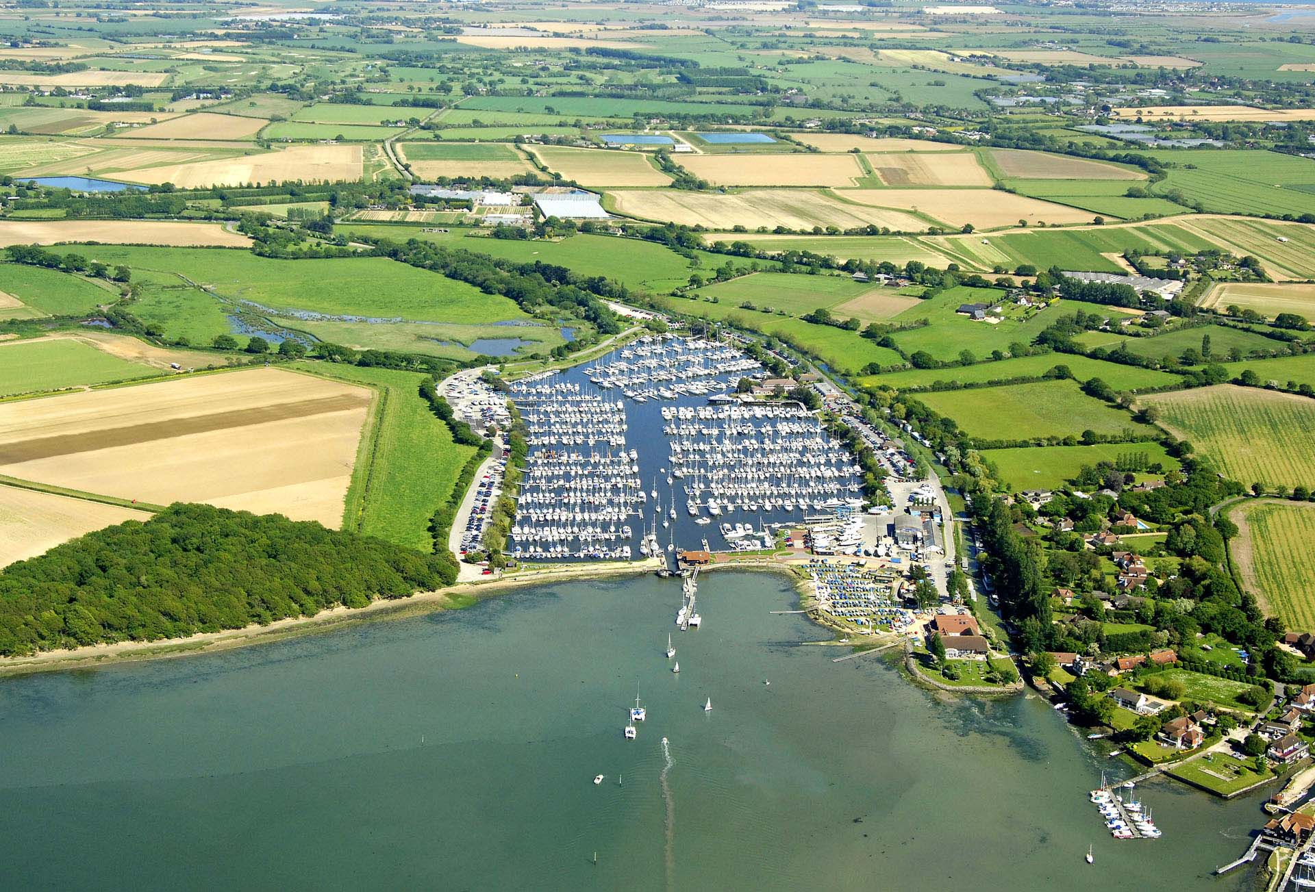 Luxury Self Catering - An aerial view of Chichester Harbour with Boats and Fields
